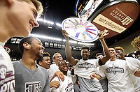 Texas A&M's Tonny Trocha-Morelos (10) holds up a Southeastern Conference sign as he and his teammates celebrate a regular season SEC championship after defeating Vanderbilt in an NCAA college basketball game, Saturday, March 5, 2016, in College Station, Texas. Texas A&M won 76-67. (AP Photo/Sam Craft)
