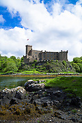 Ancient highland fortress Dunvegan Castle, the Highlands ancestral home of the MacLeod clan, by Dunvegan Loch on the Isle of Skye in Scotland