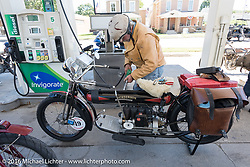 Frank Westfall of New York fuels his 4-cylinder 1912 Henderson class-2 bike during the Motorcycle Cannonball Race of the Century. Stage-4 from Chillicothe, OH to Bloomington, IN. USA. Tuesday September 13, 2016. Photography ©2016 Michael Lichter.