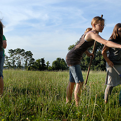 Meladeh Rabie, 16, Amber Rabie, 12, and Marie Ammar, 9, hunt for insects...Photo by Susana Raab..