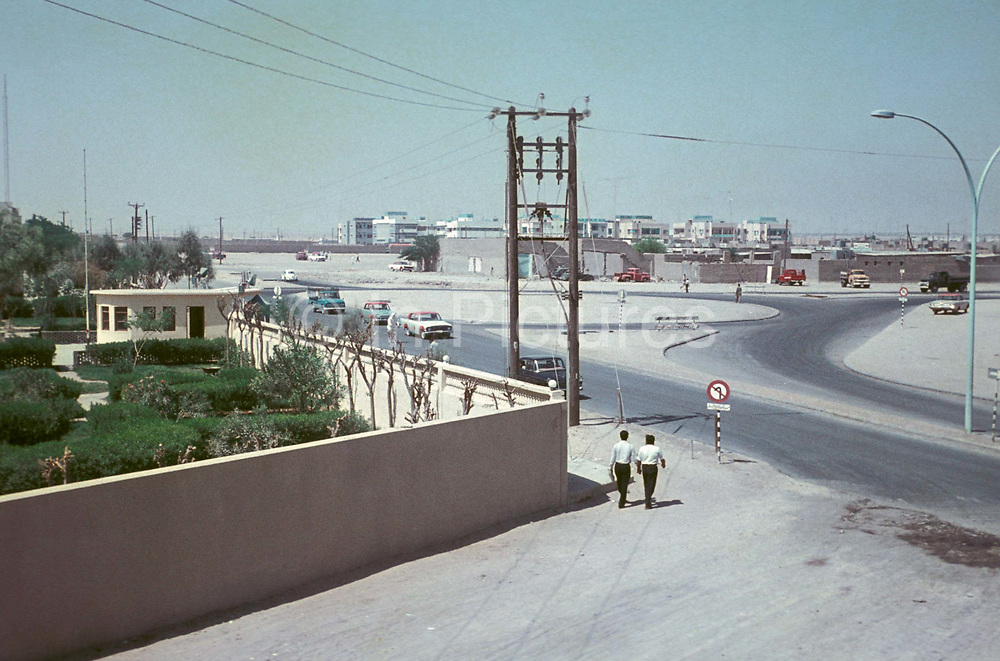 Two men walk around the corner of a property wall and towards a roundabout, on 20th March 1968, in Kuwait, Persian Gulf. The period of 1946-82 is often termed the golden period of Kuwait by western academics. In the 1960s and 1970s, Kuwait was considered by some as the most developed country in the region. Kuwait was the pioneer in the Middle East in diversifying its earnings away from oil exports. The Kuwait Investment Authority is the worlds first sovereign wealth fund. From the 1970s onward, Kuwait scored highest of all Arab countries on the Human Development Index.