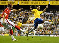 Photo: Ed Godden.<br /> Brazil v Wales. International Friendly. 05/09/2006.<br /> James Collins (L) kicks the ball past Brazil's Ronaldinho.