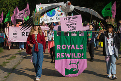 London, UK. 9th October, 2021. Climate activists, including many families, take part in a Rewild Royal Land procession to Buckingham Palace organised by Wild Card, a new campaign calling on the UK's biggest landowners to rewild, together with 38 Degrees. Campaigners including conservationist and broadcaster Chris Packham are calling on the Royal Family, the largest landowning family in the UK, to rewild their estates in order to assist with tackling the climate crisis and a 14-year-old boy presented a petition at the gates of Buckingham Palace signed by over 100,000 people.