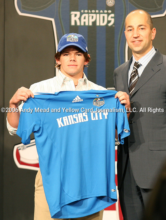 20 January 2006: MLS deputy commissioner Ivan Gazidis (r) and University of New Mexico's Lance Watson (l), who was taken by the Kansas City Wizards with the fourth pick of the second round - sixteenth overall. The 2006 MLS SuperDraft was held in the Pennsylvania Convention Center in Philadelphia, PA during the National Soccer Coaches Association of America's annual convention.