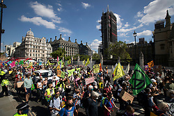 © Licensed to London News Pictures. 01/09/2020. London, UK. Extinction Rebellion activists gather in Parliament Square. The environmental activist group intend to peacefully blockade the Houses of Parliament until Parliament agrees to debate their three demands.  Photo credit: George Cracknell Wright/LNP
