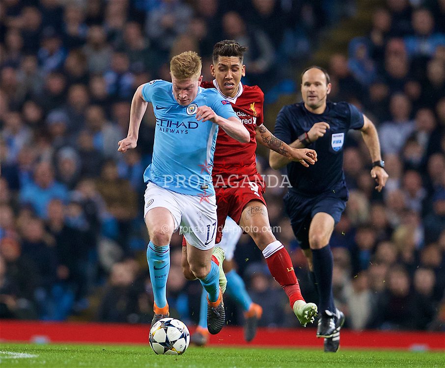 MANCHESTER, ENGLAND - Tuesday, April 10, 2018: Liverpool's Roberto Firmino (right) tackles Manchester City's Kevin De Bruyne Liverpool' during the UEFA Champions League Quarter-Final 2nd Leg match between Manchester City FC and Liverpool FC at the City of Manchester Stadium. (Pic by David Rawcliffe/Propaganda)