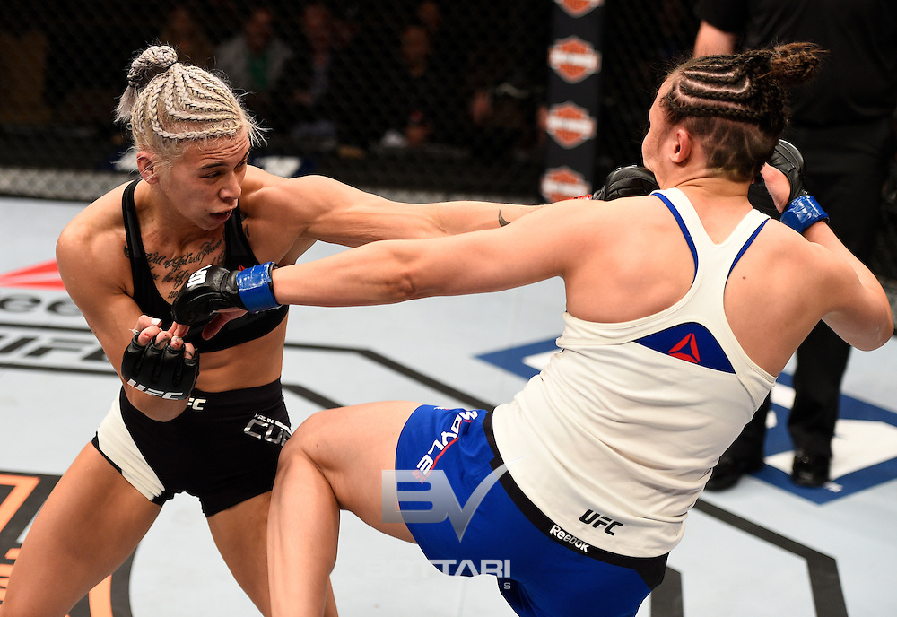 LAS VEGAS, NV - DECEMBER 03:  (L-R) Kailin Curran punches Jamie Moyle in their women's strawweight bout during The Ultimate Fighter Finale event inside the Pearl concert theater at the Palms Resort & Casino on December 3, 2016 in Las Vegas, Nevada. (Photo by Jeff Bottari/Zuffa LLC/Zuffa LLC via Getty Images)