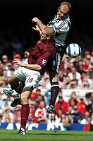 Alan Shearer<br />Newcastle United 2005/06<br />Phillipe Senderos Arsenal<br />Arsenal V Newcastle United 14/08/05<br />The Premier League<br />Photo Robin Parker Fotosports International