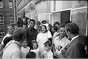 15/07/1972<br /> 07/15/1972<br /> 15 July 1972<br /> Muhammad Ali at Stewarts Hospital Fete, Palmerstown, Dublin. Ali posing with some of the crowd and members of his entourage.