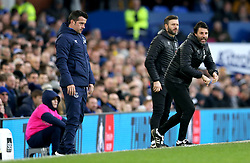 Everton manager Marco Silva (left) and Lincoln City manager Danny Cowley watch the action from the touchline