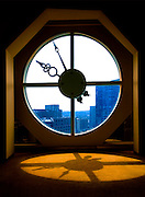 A round clock window defines the top peak of 101 Arch Street, a high rise office building located in Boston's Downtown Crossing District.  Photographed for 101 Arch Street