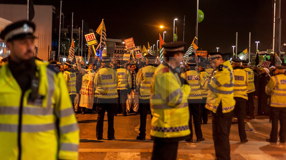 © Licensed to London News Pictures. 13/11/2015. London, UK. Pro Kashmiri supporters voice their opinions behind a police blockade outside Wembley Stadium after Indian Prime Minister Modi was special guest at a gathering for 55,000 British Indians inside the stadium. Photo credit : Stephen Chung/LNP