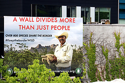 May 13, 2019 - New York City, New York, U.S. - A view of the 'A Wall Divides More Than Just People' sign by the Turtle Conservatory #KeeptheBorderWild advocacy  group on display along the High Line on the West Side in Manhattan. (Credit Image: © Nancy Kaszerman/ZUMA Wire)
