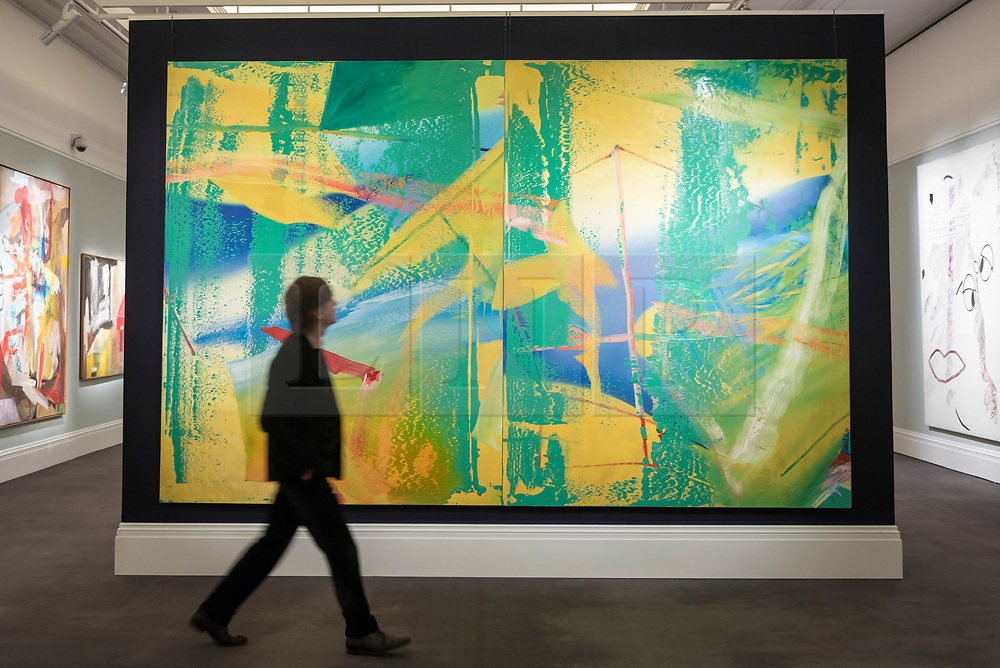 © Licensed to London News Pictures. 22/02/2018. LONDON, UK. A man walks in front of ''Gelbgrün (Yellow-Green)'' by Gerhard Richter, (Est. £7,000,000 - 10,000,000) at the preview of Sotheby's upcoming Impressionist, Modern & Surrealist Art auctions taking place at Sotheby's, New Bond Street, on 28 February. Photo credit: Stephen Chung/LNP