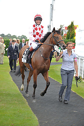 PHILIPPA HOLLAND riding Russian Bullet winner of the Magnolia Cup  at the 3rd day of the 2012 Glorious Goodwood racing festival at Goodwood Racecourse, West Sussex on 2nd August 2012.
