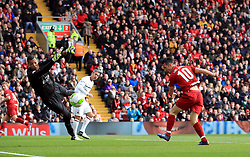 Liverpool's Luis Garcia heads wide from close range as Milan's Dida dives for the ball during the Legends match at Anfield Stadium, Liverpool.