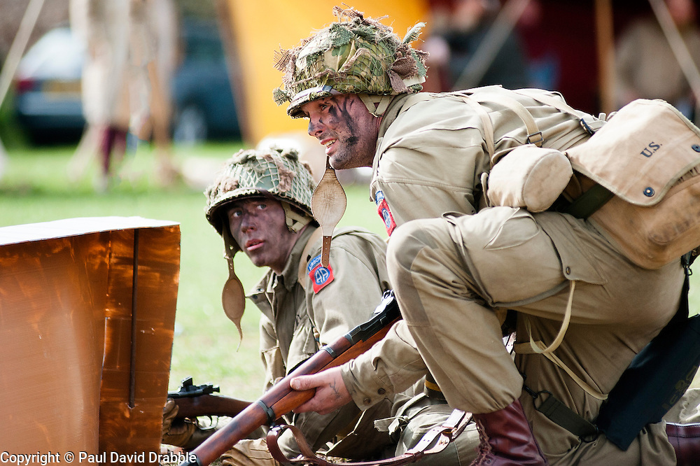 Reeactors portraying a Private and a Technician/4th Grade (T4 or Technical Sergeant)  paratrooper from the US 82nd Airborne (All American).carrying a Springfield 1903 .30-06 caliber Rifle.21 April  2013.Image © Paul David Drabble