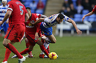 Adam Henley of Blackburn Rovers fouls Hal Robson-Kanu of Reading. Skybet football league championship match, Reading  v Blackburn Rovers at The Madejski Stadium  in Reading, Berkshire on Sunday 20th December 2015.<br /> pic by John Patrick Fletcher, Andrew Orchard sports photography.