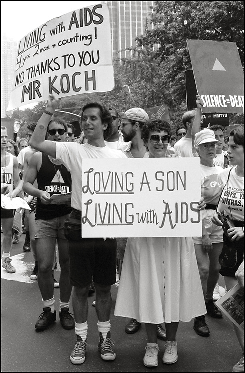 """Mark Fotopolous of ACT UP and his mom, on June 24, 1989, the 20th anniversary of the Stonewall riots, participating in a renegade march up 6th avenue to Central Park. Themed, """"In The Tradition"""", this march followed the same route as the original march 20 years ago and was designed as a rebuke to the corporatization of the gay pride parade."""