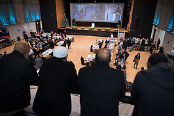 © Licensed to London News Pictures . 03/12/2015 . Oldham , UK . People watch the count at the Oldham West and Royton by-election from a balcony at the Queen Elizabeth Hall in Oldham . The by-election was called following the death of MP Michael Meacher . Photo credit: Joel Goodman/LNP