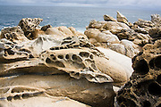 Unusual sandstone formations caused by wind erosion along the Pacific coast near the village of Mazunte, Oaxaca, Mexico on July 7, 2008.
