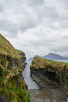 Gjogv a 200-metre (650 ft) long sea-filled gorge that runs north to the sea from the village named after it Gjogv. Faroe Islands.