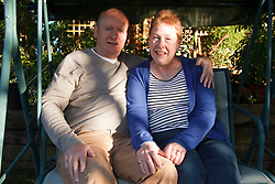 Couple relaxing in garden. Cleared for Mental Health issues.