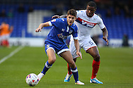 Donervon Daniels of Wigan Athletic puts Ryan Flynn of Oldham Athletic under pressure during the EFL Cup match between Oldham Athletic and Wigan Athletic at Boundary Park, Oldham, England on 9 August 2016. Photo by Simon Brady.