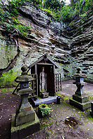 """Buddha Cave at Eishoji - Eisho-ji is the only convent remaining in Kamakura and was built in the early Edo Period in 1636.  Its full name is Tokozan Eishoji but it is almost always called just Eishoji.  It's nickname is the """"flower temple"""" though it is most noteworthy for its bamboo grove and cave niches with buddha statues inside.   Eishoji was founded as a nunnery by Okatsu, the temple's named was derived from her nun name Eiisho-in."""