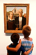 CHICAGO, MUSEUMS and ARTISTS Art Institute of Chicago 'American Gothic' by Grant Wood with two boys viewing