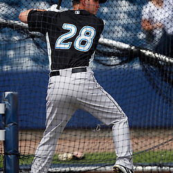 March 8, 2011; Port Charlotte, FL, USA; Toronto Blue Jays first baseman David Cooper (28) takes batting practice before a spring training exhibition game against the Tampa Bay Rays at Charlotte Sports Park.   Mandatory Credit: Derick E. Hingle