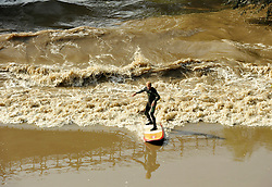 © Licensed to London News Pictures. 10/09/2014. Over Bridge, Gloucestershire, UK.  Surfers and kayakers try to catch this morning's Severn Bore by Over Bridge. Photo credit : Simon Chapman/LNP