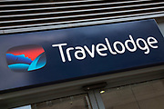 Sign for the hotel brand Travelodge in Birmingham, United Kingdom.