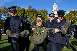 "© Licensed to London News Pictures. 21/10/2014. LONDON, UK. Occupy London protesters at Parliament Square being evicted by police officers on Tuesday, 21 October 2014, 4 days after they started to occupy the square in Westminster. A police statement said ""The tarpaulin has been removed and fifteen people have been arrested for failing to provide details suitable for a summons""  Photo credit : Tolga Akmen/LNP"
