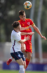 NEWPORT, WALES - Friday, September 3, 2021: Wales' Luke Harris (R) challenges for a header with England's Daniel Gore during an International Friendly Challenge match between Wales Under-18's and England Under-18's at Spytty Park. (Pic by David Rawcliffe/Propaganda)