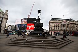 © Licensed to London News Pictures. 15/03/2020. London, UK. Piccadilly Circus appears quiet this afternoon . New cases of the COVID-19 strain of Coronavirus are being reported daily as the government outlines it's plans for controlling the outbreak. Photo credit: George Cracknell Wright/LNP