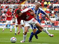 Photo: Ed Godden.<br />Bristol City v Brighton & Hove Albion. Coca Cola League 1. 02/09/2006. Phil Jevons (L) is challenged by Brighton's Adam El-Abd.
