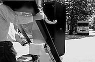 2011 September 07 - Men pushing office equipment cross Jackson Street in Pioneer Square, Seattle, WA, USA. Copyright Richard Walker
