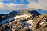 Morning clouds shroud the summit cap of Snowmass Mountain 14,092ft, Elk Mountains, Colorado.