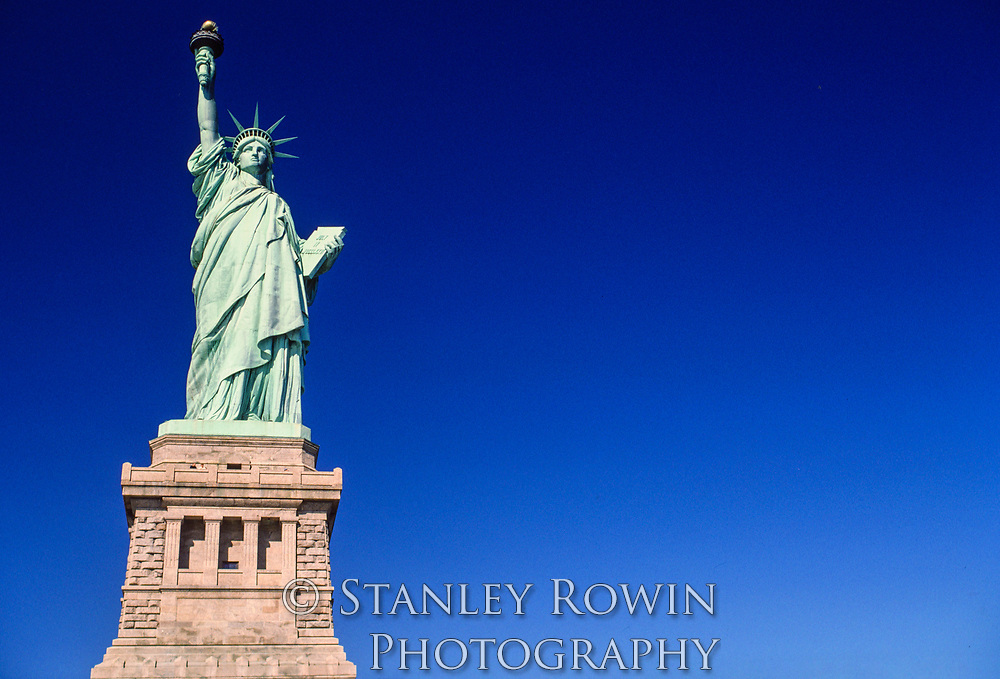 Statue of Liberty on a sunny day with clear blue sky