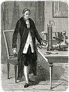 Alessandro Volta (1745-1827) Italian physicist, demonstrating his electric pile (battery). Wood engraving, Paris, c1870.