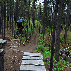 Pete Hoang riding the Switchyard on Race of Spades at Moose Mountain in Alberta, Canada