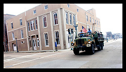 3rd Sept, 2005. Hurricane Katrina aftermath. An army truck full of evacuees passes through the Central Business district in New Orleans.