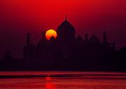 Taj Mahal at sunrise from Yamuna / Jumna riverbank, Agra, India