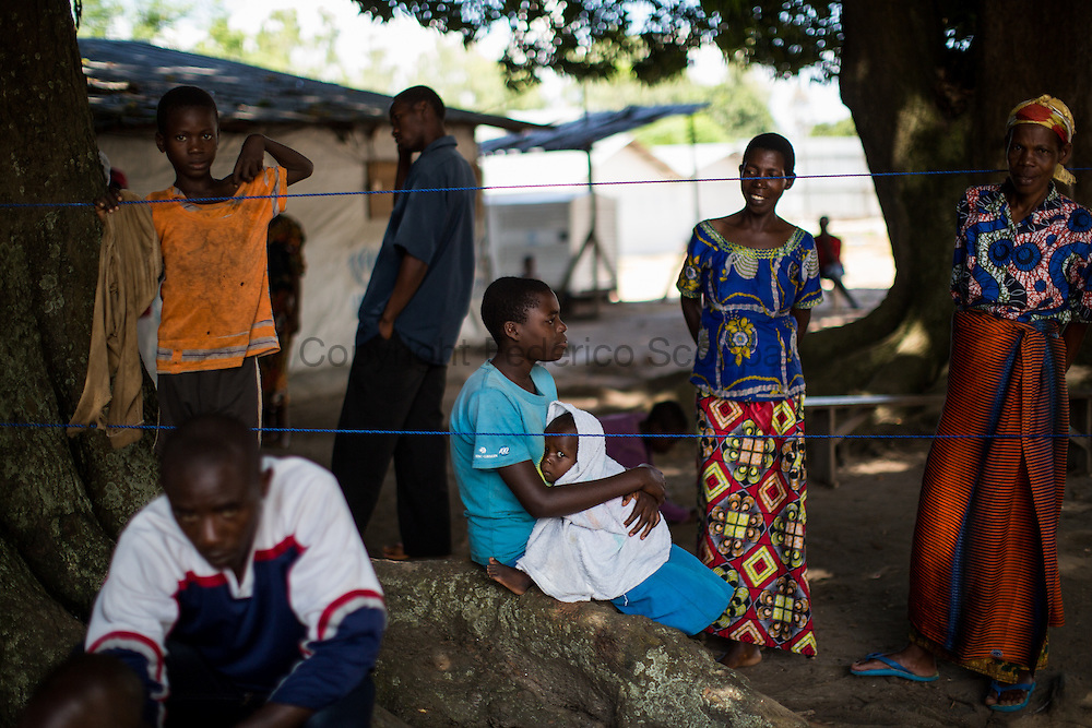 DRC / Burundi Refugees / Women seat with their children outside of their tent in Kavimvira transit<br /> centre run by UNHCR in Uvira, DRC's South Kivu Province.<br /> 700 vulnerable Burundian refugees are hosted in Kavimvira transit centre. The<br /> majority are women and children.<br /> <br /> More than 9000 Burundians refugees have crossed into the DRC over the past few weeks. The new<br /> arrivals are being hosted by local families, but the growing numbers are straining<br /> available support. UNHCR is helping some 700 vulnerable refugees at a transit centre<br /> at Kavimvira and in another centre at Sange. Work is ongoing to identify a site<br /> where all the refugees can be moved, and from where they can have access to<br /> facilities such as schools, health centers and with proper security. / UNHCR / F.Scoppa / May 2015
