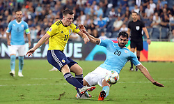 Israel's Omri Ben Harush (right) and Scotland's Callum McGregor battle for the ball during the UEFA Nations League Group C1 match at the Sammy Ofer Stadium, Haifa.