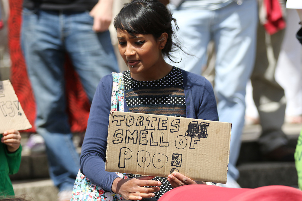 A protester highlights her anger against cuts to public services during a People's Assembly march in Cardiff