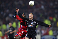 FOOTBALL - CHAMPIONS LEAGUE 2003/04 - 1/8 FINAL - 2ND LEG - 040309 - OLYMPIQUE LYONNAIS v REAL SOCIEDAD - LIONEL POTILLON (REAL) / SYDNEY GOVOU (LYON) - PHOTO GUY JEFFROY /  DIGITALSPORT