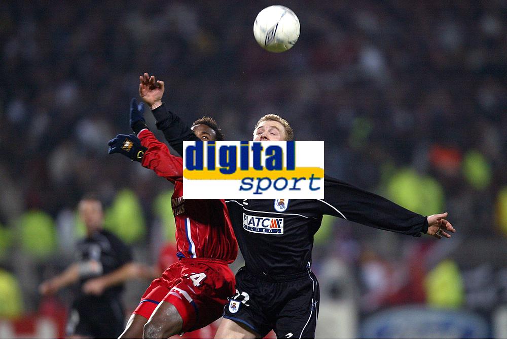 FOOTBALL - CHAMPIONS LEAGUE 2003/04 - 1/8 FINAL - 2ND LEG - 040309 - OLYMPIQUE LYONNAIS v REAL SOCIEDAD - LIONEL POTILLON (REAL) / SYDNEY GOVOU (LYON) - PHOTO GUY JEFFROY /  DIGITALSPORT
