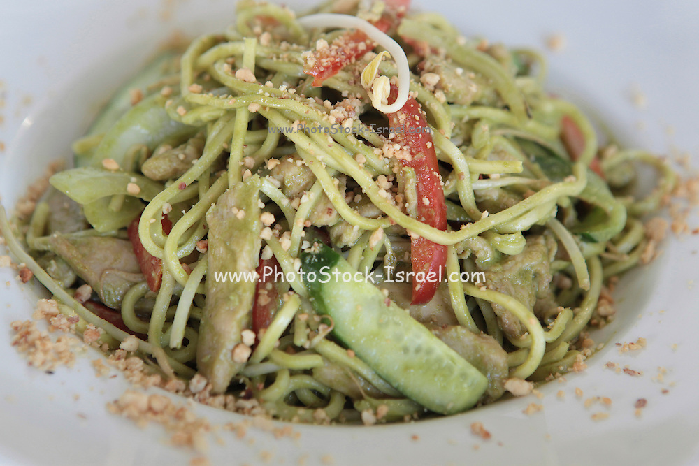 Stir fried vegetarian noodles with nuts and shoots